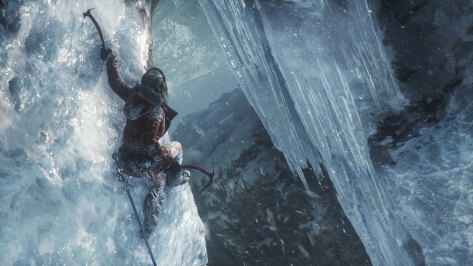 Lara clings to an ice wall with her red pickaxe, preparing to make a big leap.